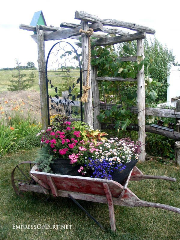 Rustic Arch with Old Red Farm Cart.