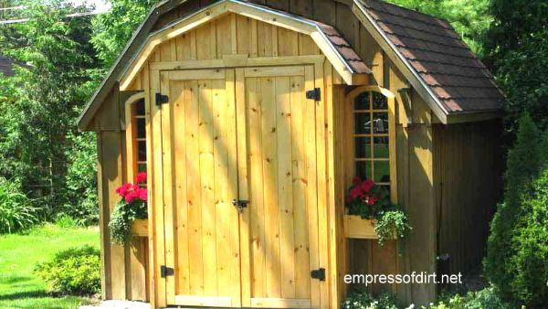 Barn shaped shed with punch out doors.