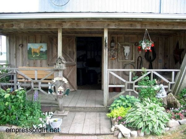 Rustic garden shed with cowboy and horse theme.