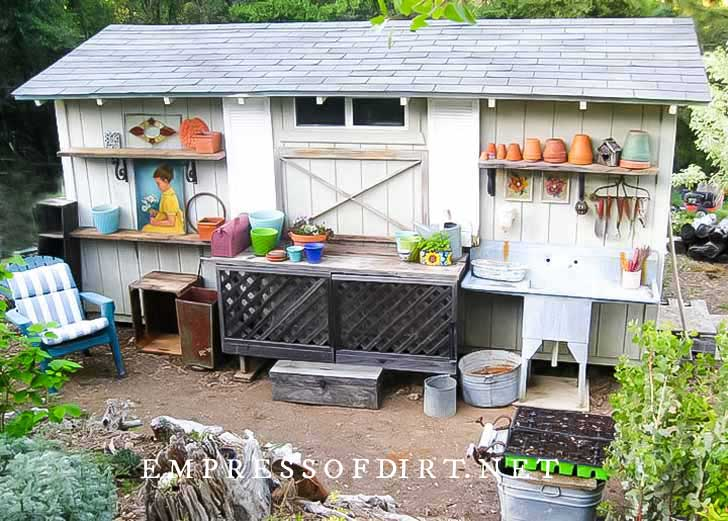 Garden shed with potting bench in front.