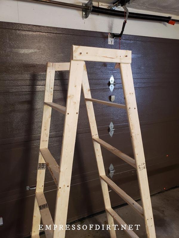 Assembling a homemade decorative garden ladder.