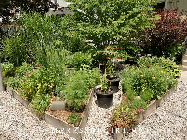 Triangular shaped raised garden beds.