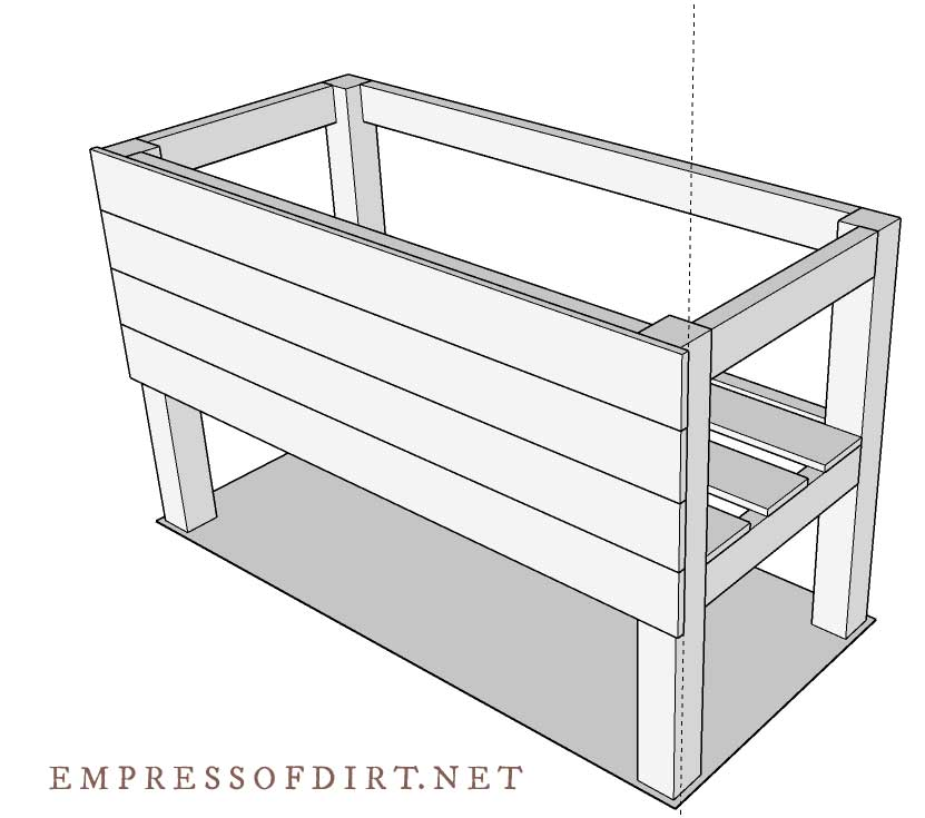 Frame for tall raised bed with front fence boards attached.