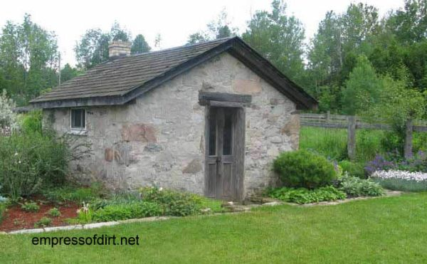 Old stone outbuilding used as a garden shed.