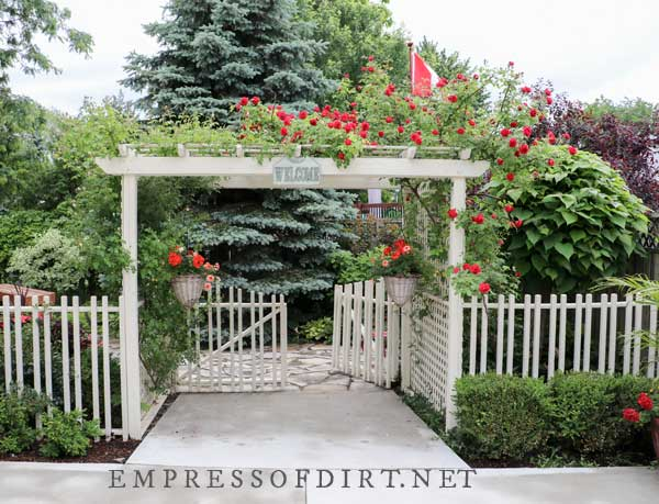 White Fence with Rose Arbor