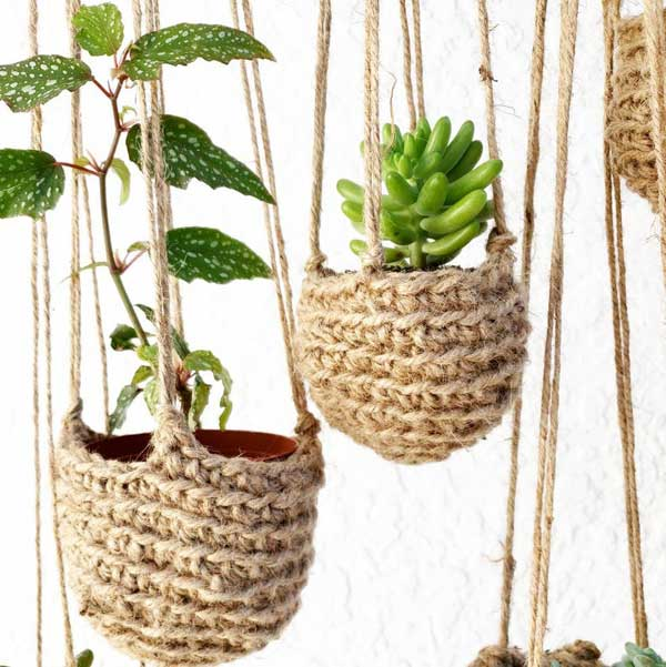 Crocheted plant holders made from jute twine.