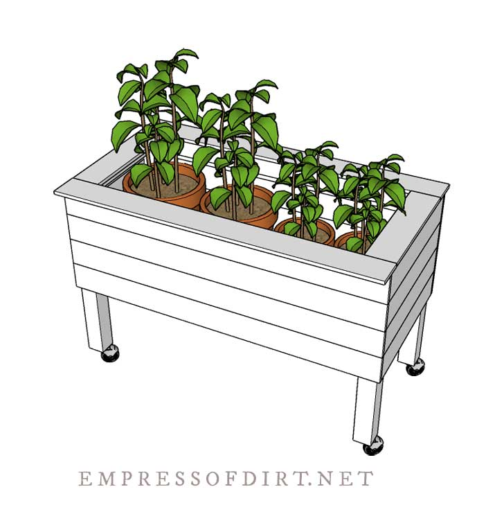 Tall raised bed with potted plants inside.