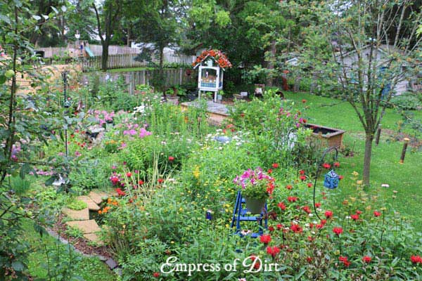 Colorful summer garden with flowers and garden art.