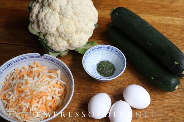Ingredients for making cheesy cauliflower & zucchini breadsticks.