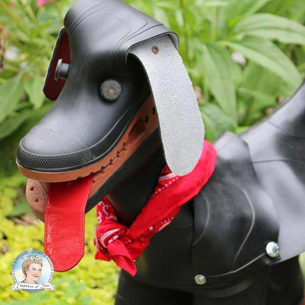 Rubber boot dog with red belt for tongue.