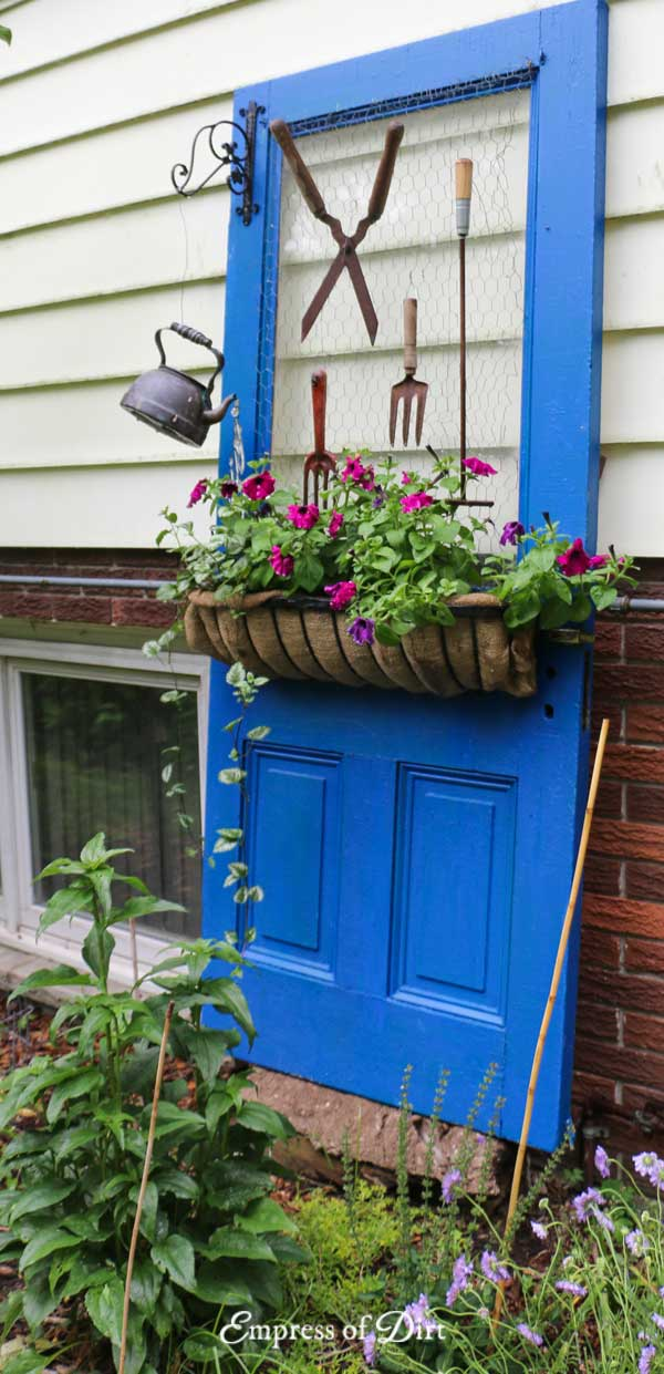 Old farmhouse door used as garden art.