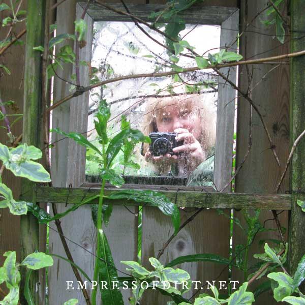 Garden mirror on fence.