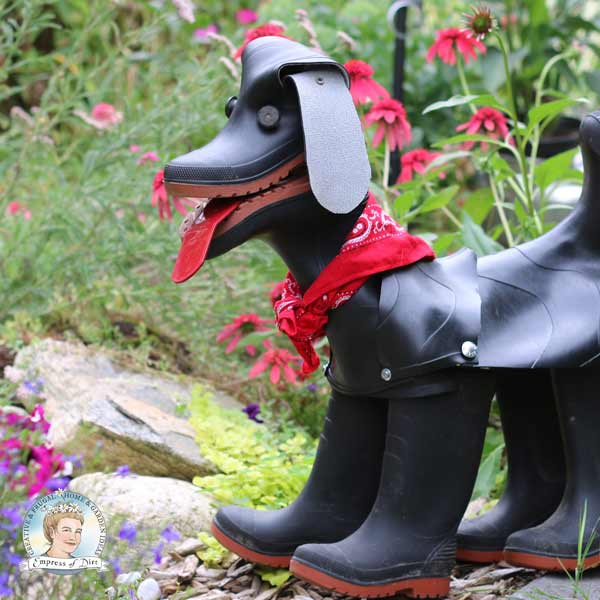 Rubber boot dog wearing red bandana scarf.