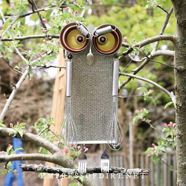 Kitchen utensils made into garden art owl.