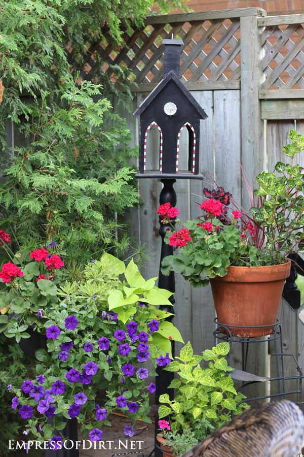 Black cathedral style birdhouse feeder.