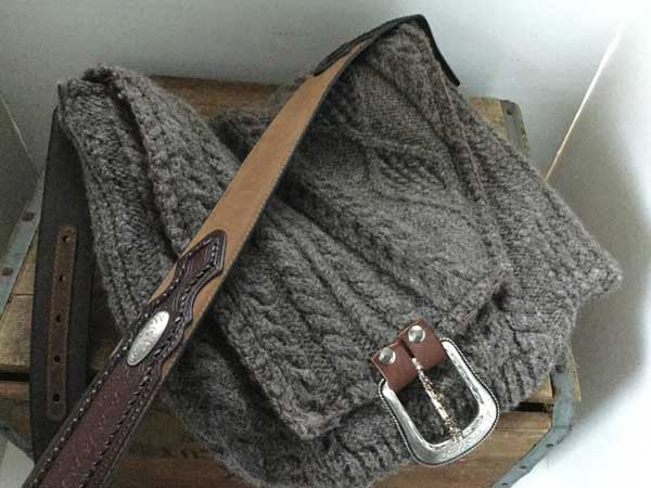 Cross body bag made from old sweater and belt.