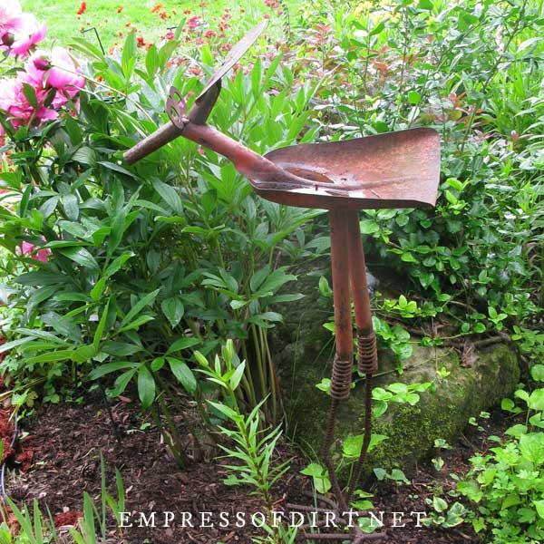 Old tools made into garden art bird.
