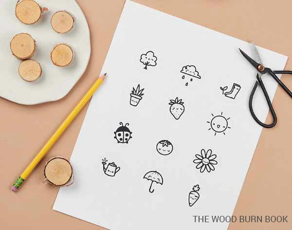 Decorative magnet project from The Wood Burn Book showing simple designs printed on paper.