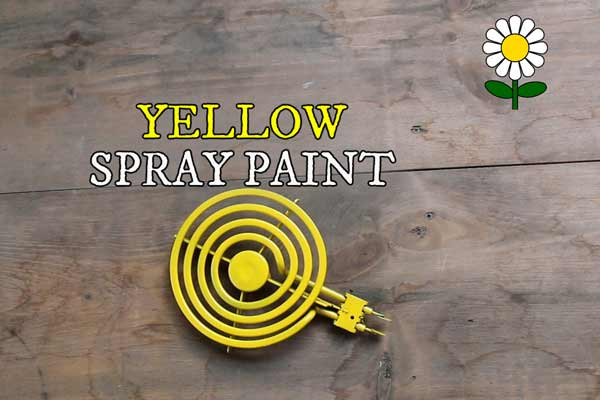 Old stove element painted yellow to represent the middle of a garden art daisy flower.