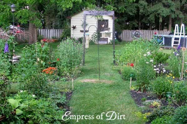 Want to see how a garden changes year after year? These photos show my backyard garden which started as a plain, grass lawn in 2011.