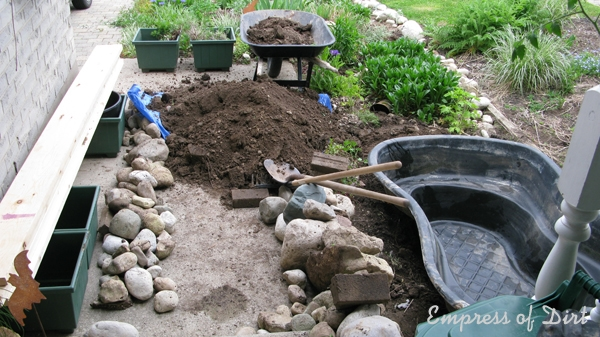 Build a small pond in a raised garden bed empress of dirt for Raised fish pond designs