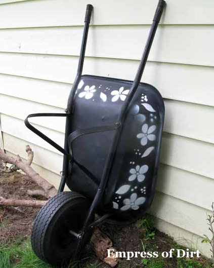 Give a rusty old wheelbarrow a new life with some spray paint and homemade stencils.