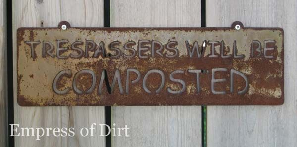 Trespassers will be composted garden sign.