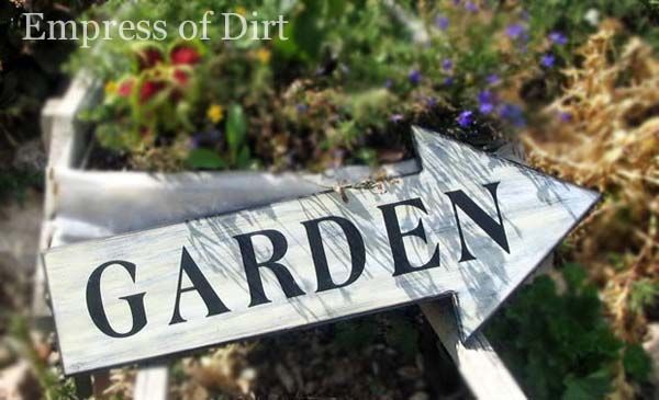 Sign saying GARDEN with an arrow pointing in one direction.