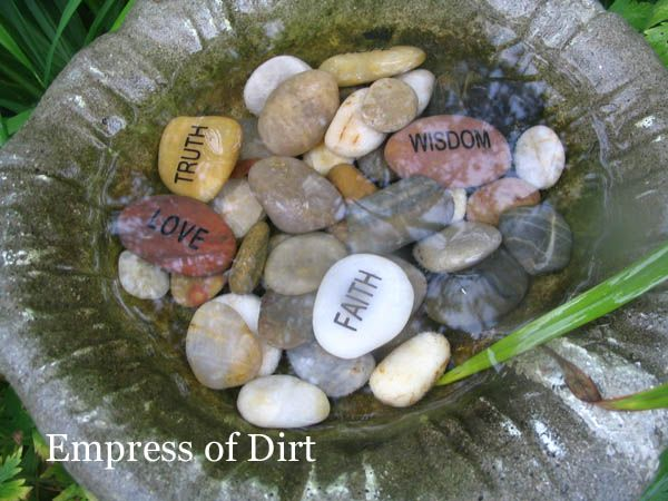 Stones engraved with words including truth, wisdom, faith, and love.