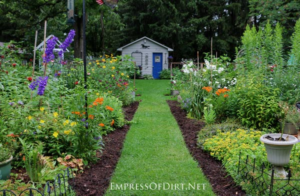 Empress of Dirt backyard garden at its peak in July. Perennials, vegetables, fruits, and shrubs fill the space.