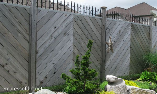 The diagonal placement of wood on this fence gives a really elegant look and provides complete privacy.