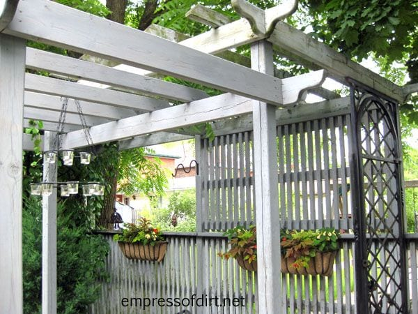 Privacy screen beside an outdoor sitting area  Gives some sense of  seclusion without being boxed. Garden Fence   Screen Privacy Ideas   Empress of Dirt