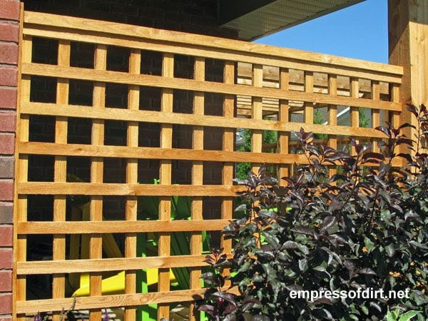 This square privacy lattice design offers some protection yet allows light and air to flow in. It's a good-looking option for many patio areas without appearing too boxy.
