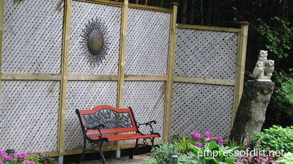 Full privacy screen creates a nice backdrop for this sitting area in the garden.