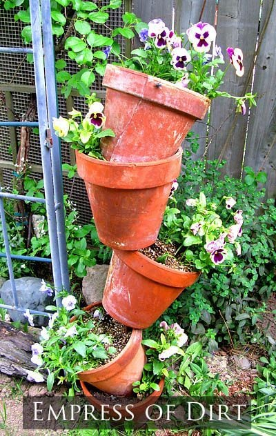 Stacked clay flower pots with pansies.
