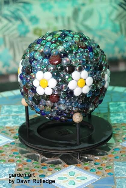 Garden art ball with daisy design created by Dawn Rutledge