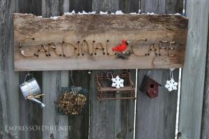 Cardinal Cafe garden art sign with decorations