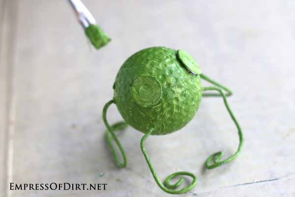 Painting golf ball frog.