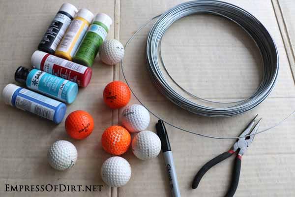 Supplies for making golf ball garden art bugs.
