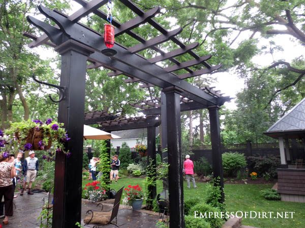 20+ Ways to create vertical interest in the garden with arbors, trellis, obelisks, and more. This tall structure defines the patio area.