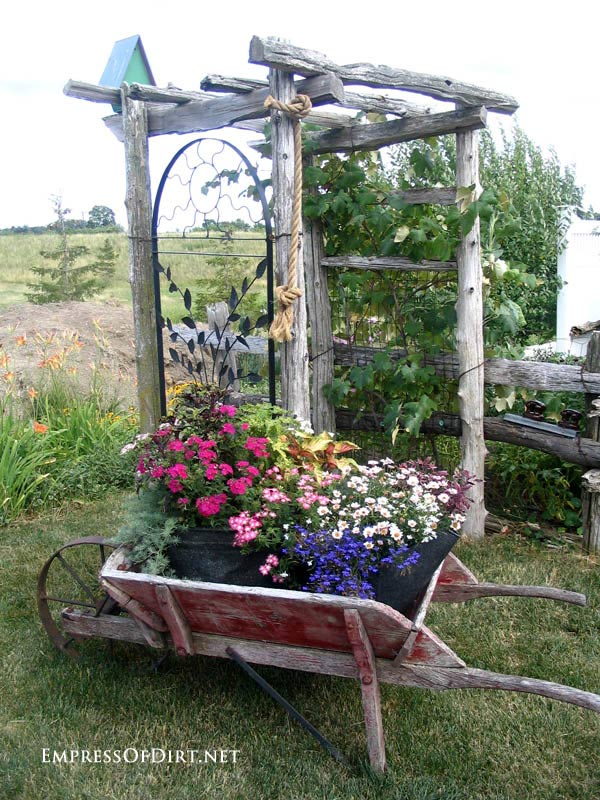 20+ Ways to create vertical interest in the garden with arbors, trellis, obelisks, and more. Rustic arbor with metal trellis sides.