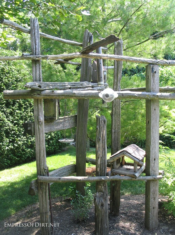 Rustic garden decor with old fence rails.