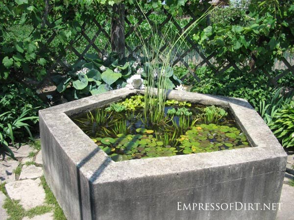 Raised Garden Pond Ideas :  backyard pond ideas for all budgets  Old well made into a pond