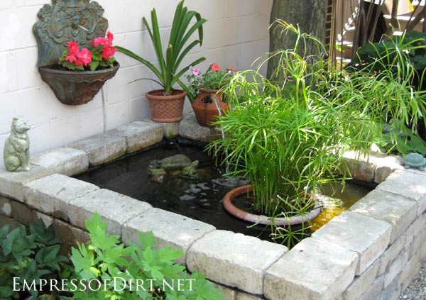 Small Garden Pond Ideas garden pond with flowers and shrubs Beautiful Backyard Pond Ideas For All Budgets Raised Stone Container Pond