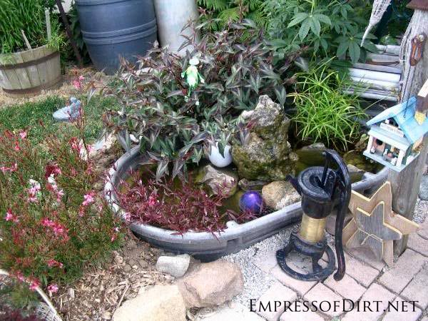 Small Garden Pond Ideas stone garden path and pond surrounded by plants backyard landscaping ideas Beautiful Backyard Pond Ideas For All Budgets Stock Tank Converted Into Garden Pond