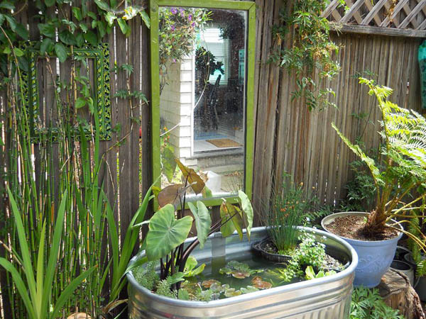 17 beautiful backyard pond ideas for all budgets for Diy small pond ideas