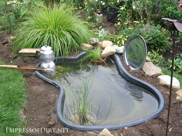 17 beautiful backyard pond ideas for all budgets for Plastic garden fish ponds