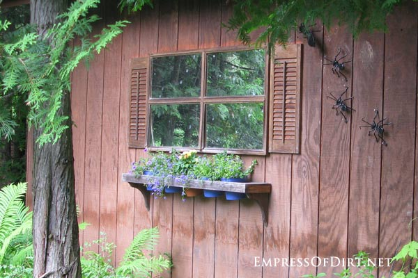 Mirrored window on side of shed - gallery of garden ideas