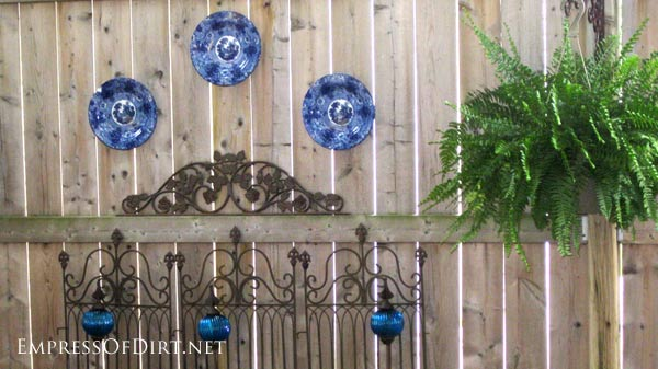 Dishes on a garden fence