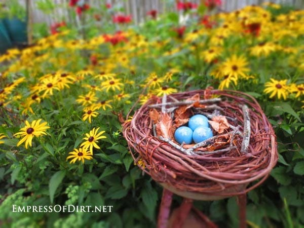 Garden art bird nest with blue eggs
